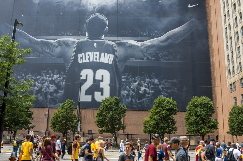 Cleveland fans walk in front of a LeBron James mural located on Ontario St. during the Cleveland Cavaliers 2016 NBA Championship victory parade and rally on June 22, 2016 in Cleveland, Ohio. (Angelo Merendino/Getty Images)