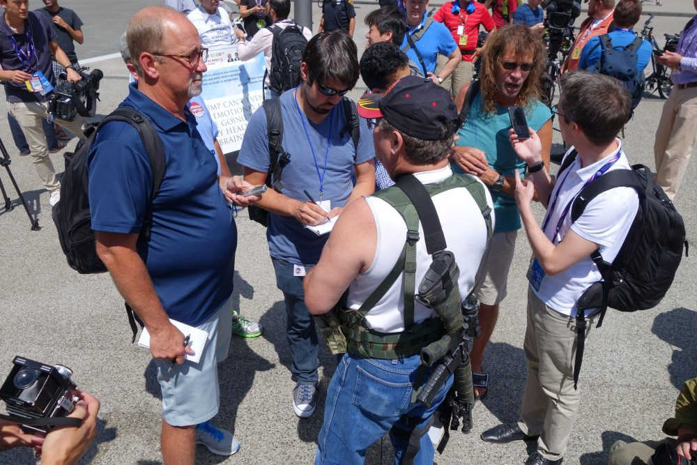 Steve Thacker (center), a member of a group supporting the carrying of weapons, openly speaks to the media at an open carry event July 17, 2016 in Cleveland, Ohio, site of the Republican National Convention. (William Edwards/AFP/Getty Images)