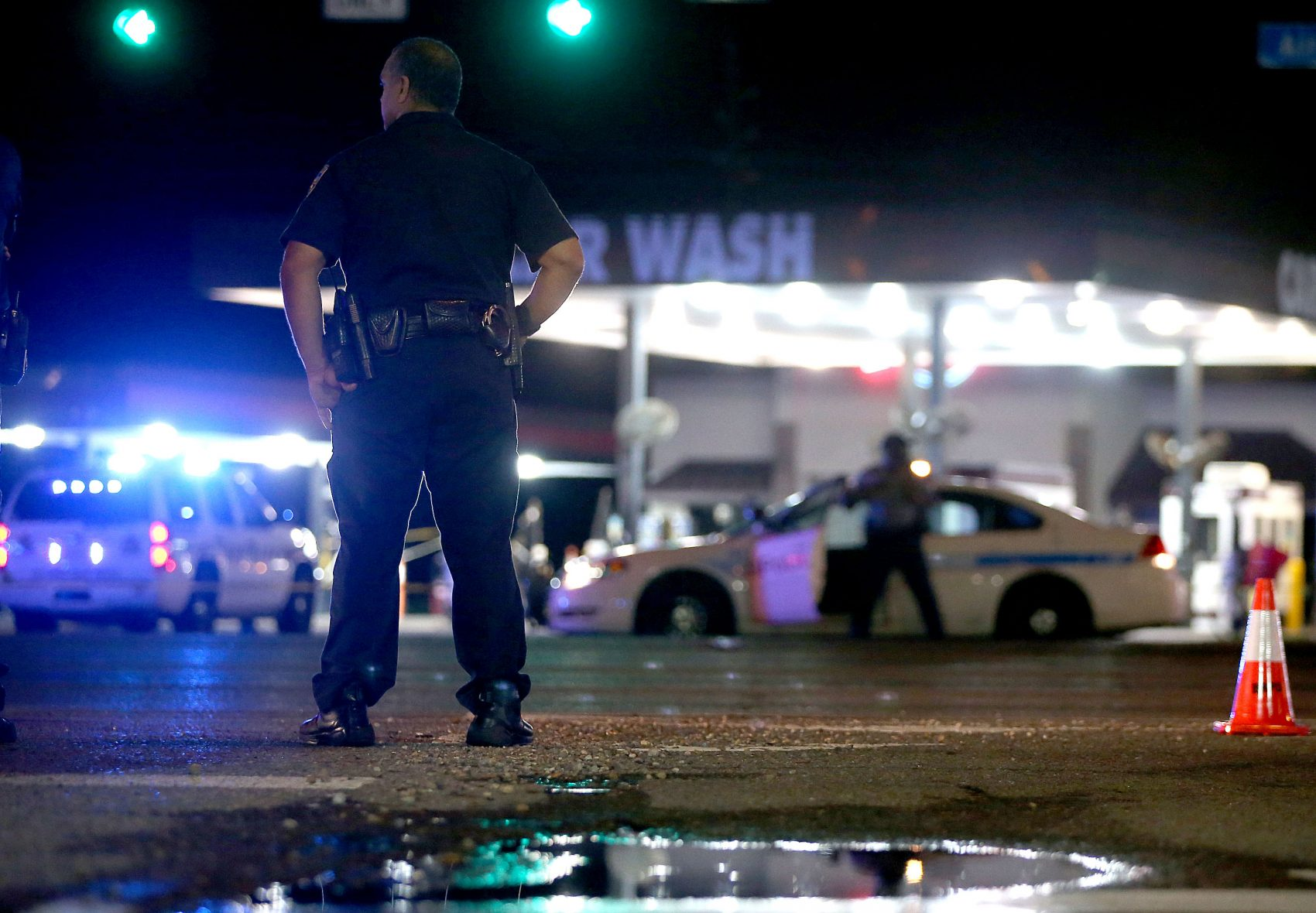 Police officers stand near the scene of where three police officers were killed on July 17, 2016 in Baton Rouge, Louisiana. The suspect, identified as Gavin Long of Kansas City, is dead after killing three police officers and injuring three more. (Sean Gardner/Getty Images)