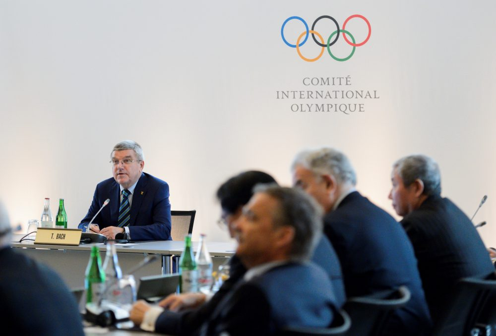 International Olympic Committee (IOC) president Thomas Bach (L) attends an Olympic summit on June 21, 2016 in Lausanne. For Russia's track and field stars, the meeting of Olympic executives may offer the last chance to compete at the Games in Rio de Janeiro. Last week, the International Association of Athletics Federations (IAAF) upheld a ban on Russian athletes, first imposed in November, following revelations of state-sponsored doping and massive corruption riddling the nation's track and field programme. (FABRICE COFFRINI/AFP/Getty Images)