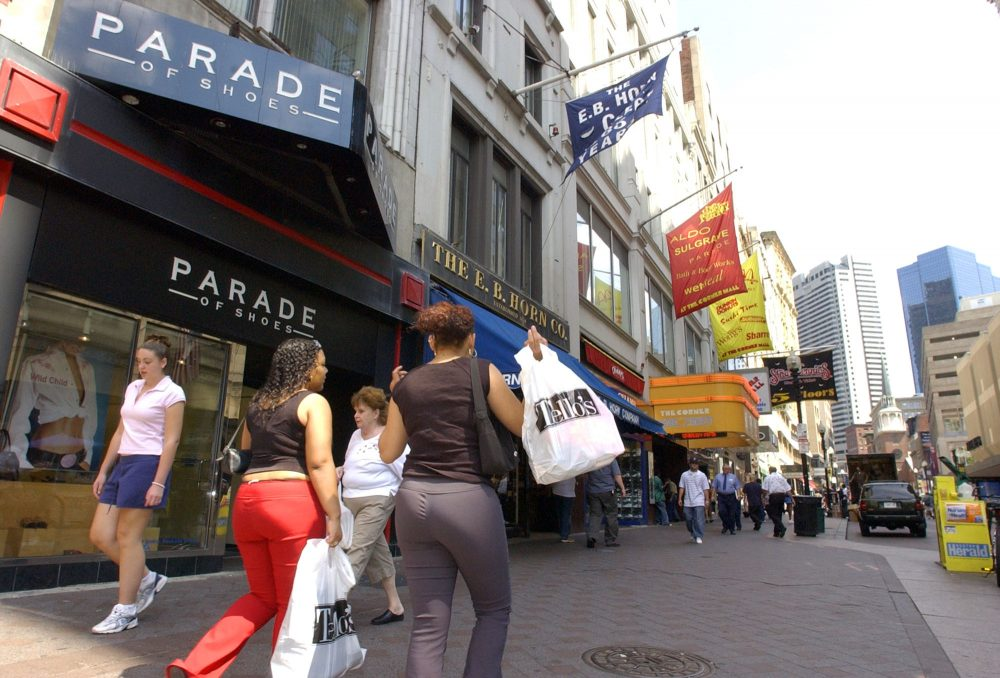 Women shop in Downtown Crossing in Boston on Aug. 10, 2004, during a sales tax holiday. The holiday has been something of an August tradition since then. (Lisa Poole/AP)