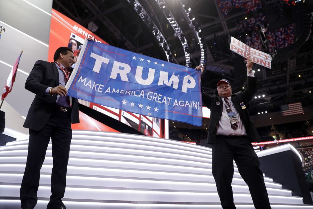 Trump supporters cheer during first day of the Republican National Convention in Cleveland Monday. (Matt Rourke/AP)