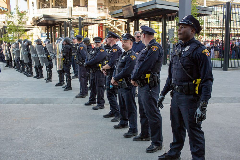 Police in front of Progressive Field stand guard during demonstrations in reaction to Cleveland police officer Michael Brelo being acquitted of manslaughter charges after he shot two people at the end of a 2012 car chase in which officers fired 137 shots May 23, 2015 in Cleveland, Ohio. (Ricky Rhodes/Getty Images)