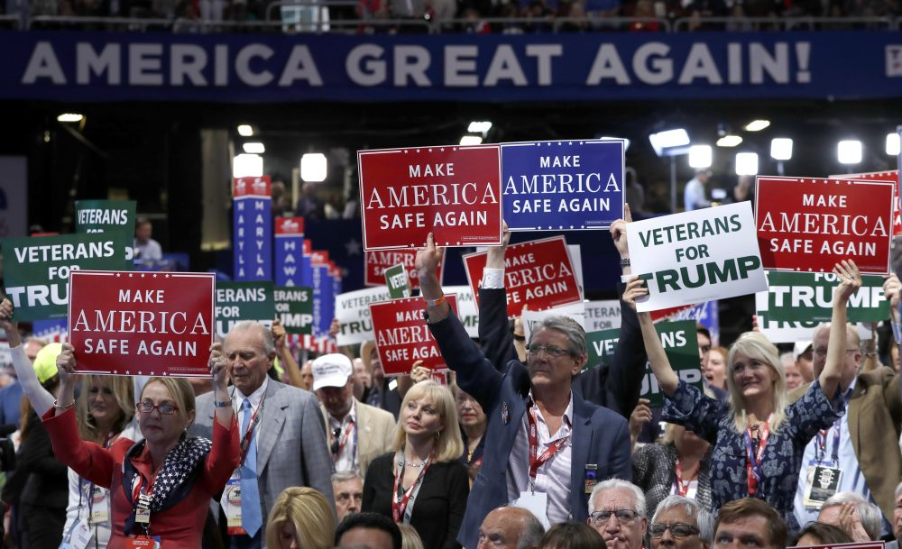 Delegates hold up signs and cheer Monday -- the first day of the Republican National Convention in Cleveland.(Carolyn Kaster/AP)