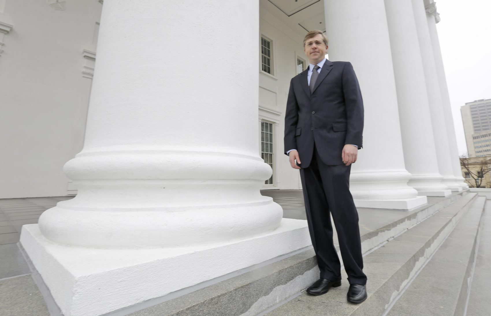 "Republican strategist Chris Jankowski poses outside the Capitol in Richmond, Virginia in March 2014. Jankowski features prominently in author David Daley's book ""Ratf**ked."" (Steve Helber/AP)"