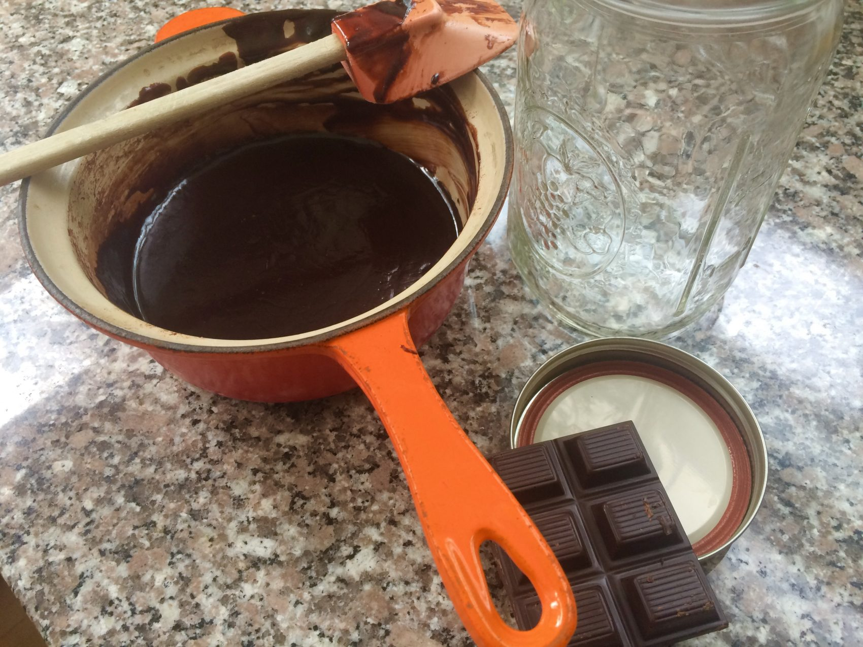 A pot containing melted dark chocolate, the key ingredient for Kathy's hot fudge sauce. (Kathy Gunst for Here & Now)