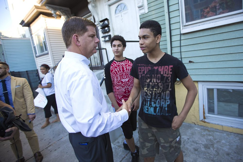 Mayor Marty Walsh stops to speak with Joshua Lewis on Chelsea Street. (Jesse Costa/WBUR)