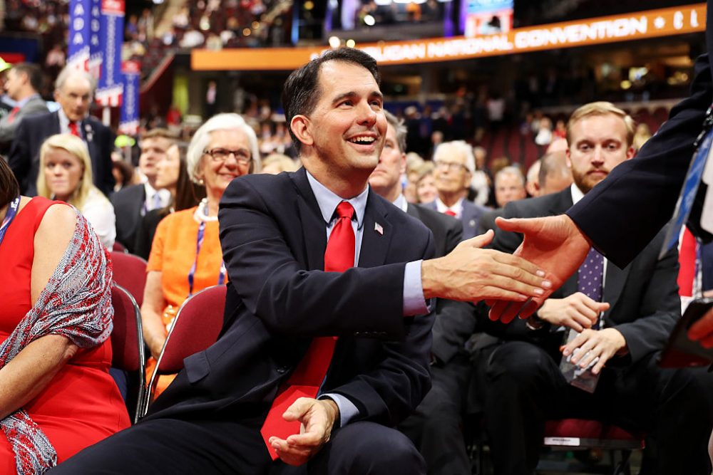 Wisconsin Gov. Scott Walker shakes hands with a delegate on the first day of the Republican National Convention on July 18, 2016 at the Quicken Loans Arena in Cleveland, Ohio. (Joe Raedle/Getty Images)