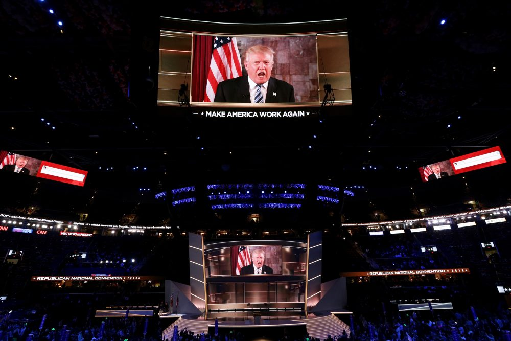 Republican presidential candidate Donald Trump is seen speaking on a screen from New York City, on the second day of the Republican National Convention on July 19, 2016 at the Quicken Loans Arena in Cleveland, Ohio. Republican presidential candidate Donald Trump received the number of votes needed to secure the party's nomination. An estimated 50,000 people are expected in Cleveland, including hundreds of protesters and members of the media. (Alex Wong/Getty Images)