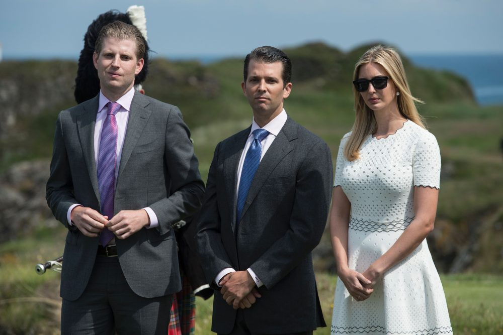 The children of Donald Trump, Ivanka Trump (R), Donald Trump Jr. (C) and Eric Trump, listen as their father delivers a speech at the official opening of his Trump Turnberry hotel and golf resort in Turnberry, Scotland on June 24, 2016. (OLI SCARFF/AFP/Getty Images)
