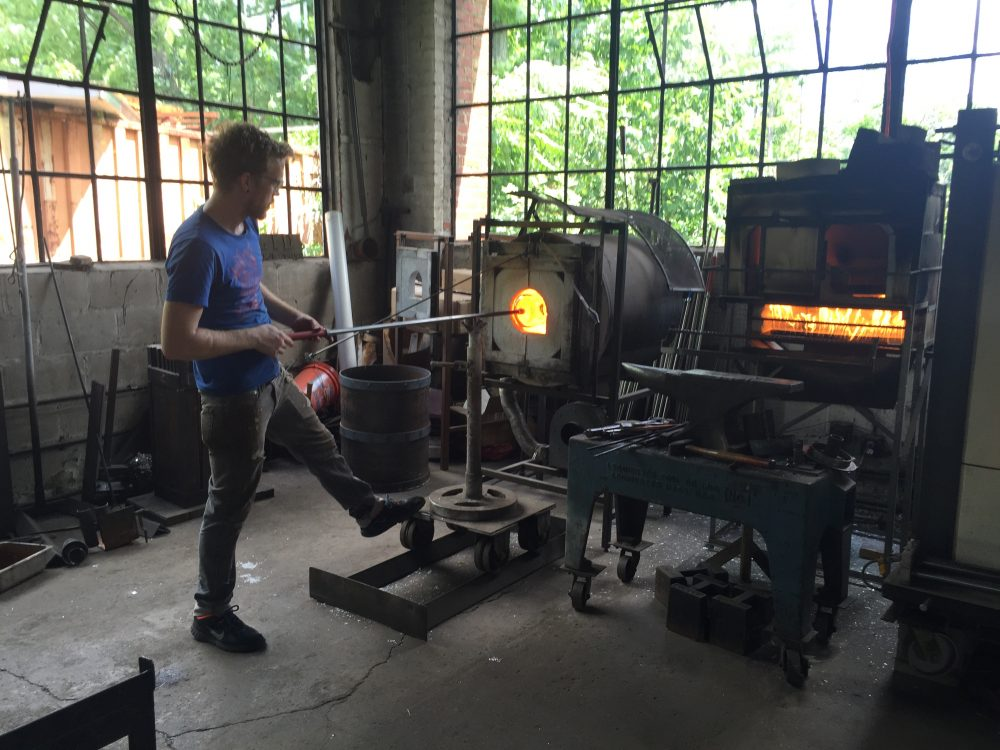 Glassblower Chris Adamick at work in the Cleveland Art workshop. (Robin Young/Here & Now)