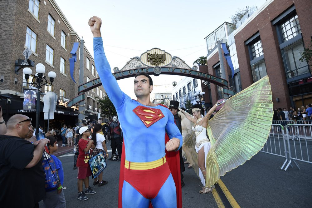 Sergio Valente, dressed as Superman, poses next to Isis Cress, dressed as the goddess Isis, outside on day one of Comic-Con International held at the San Diego Convention Center, Thursday, July 21, 2016 in San Diego. (Denis Poroy/Invision/AP)
