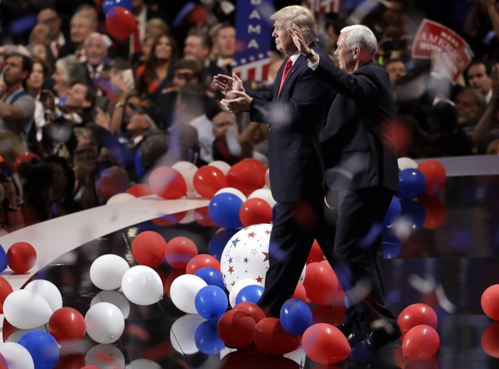 Republican presidential candidate Donald Trump walks with vice presidential candidate Gov. Mike Pence of Indiana as confetti and balloons fall during celebrations after Trump's acceptance speech on the final day of the Republican National Convention. (Matt Rourke/AP)