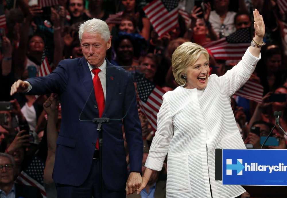 In this June 7, 2016, file photo, former President Bill Clinton, stands on stage with his wife, Democratic presidential candidate Hillary Clinton, after speaking at a primary  rally in New York. If Hillary Clinton wins the 2016 election, she will be the first presidential spouse of a former president. (Julio Cortez/ AP)