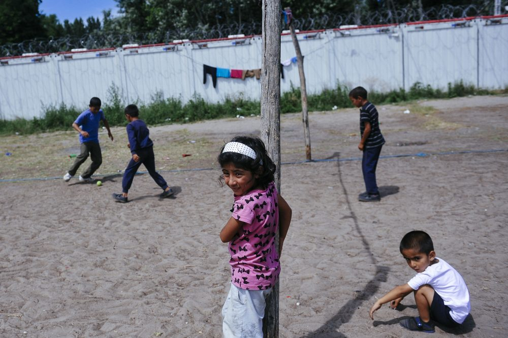Children play at a migrant camp situated on the Serbia-Hungary border in Horgos on July 8, 2016.  Exhausted but hopeful, hundreds of migrants defy summer heat in a makeshift camp on the Serbia-Hungary border, determined to reach the EU member despite tough new measures aimed at stopping them. (Alexa Stankovic/AFP/Getty Images)
