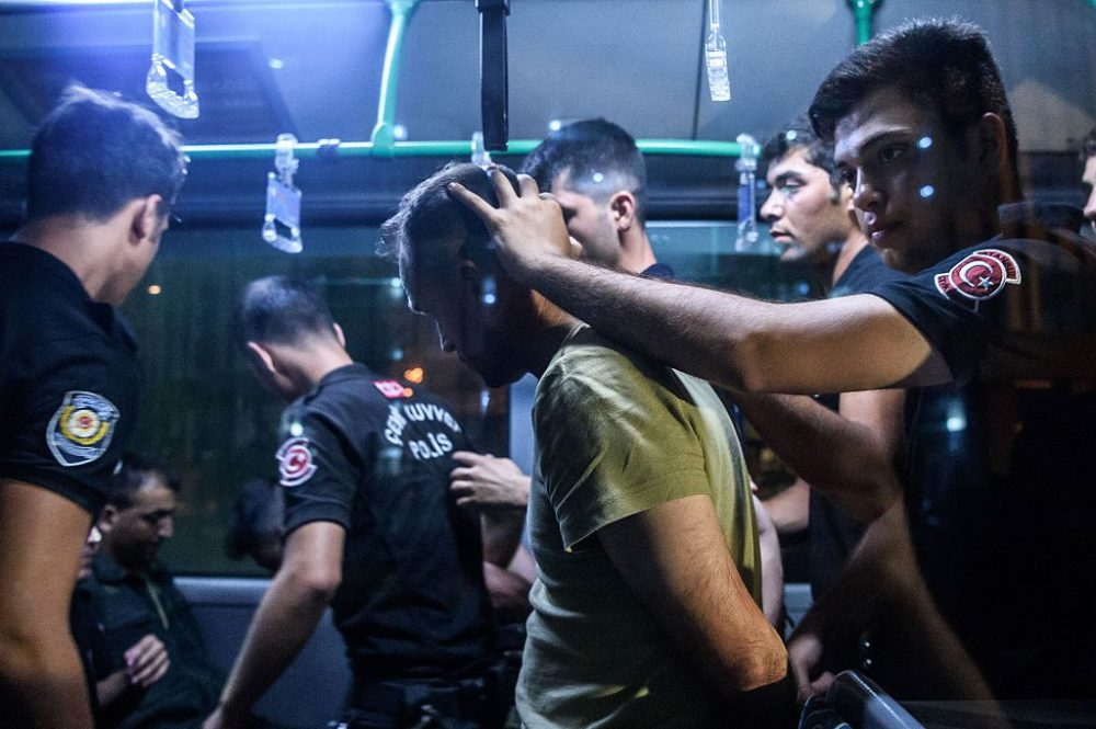Turkish anti riot police officers detain a Turkish soldier who allegedly took part in a military coup as they are leaving in a bus the courthouse at Bakirkoy district in Istanbul on July 16, 2016.  (Ozan Kose / AFP/Getty Images)