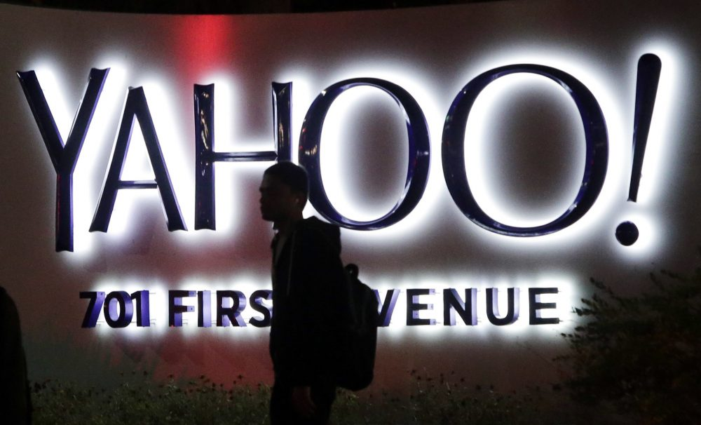 A person walks in front of a Yahoo sign at the company's headquarters in Sunnyvale, Calif. Verizon bought Yahoo in a sale announced Monday, July 25, 2016. (Marcio Jose Sanchez/AP)