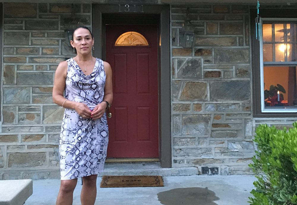 Anita Colon. stands outside her house in Philadelphia. Her brother, Robert Holbrook, was sentenced to life in prison without the possibility of parole in 1990, at the age of 16. (Samantha Fields/Here & Now)
