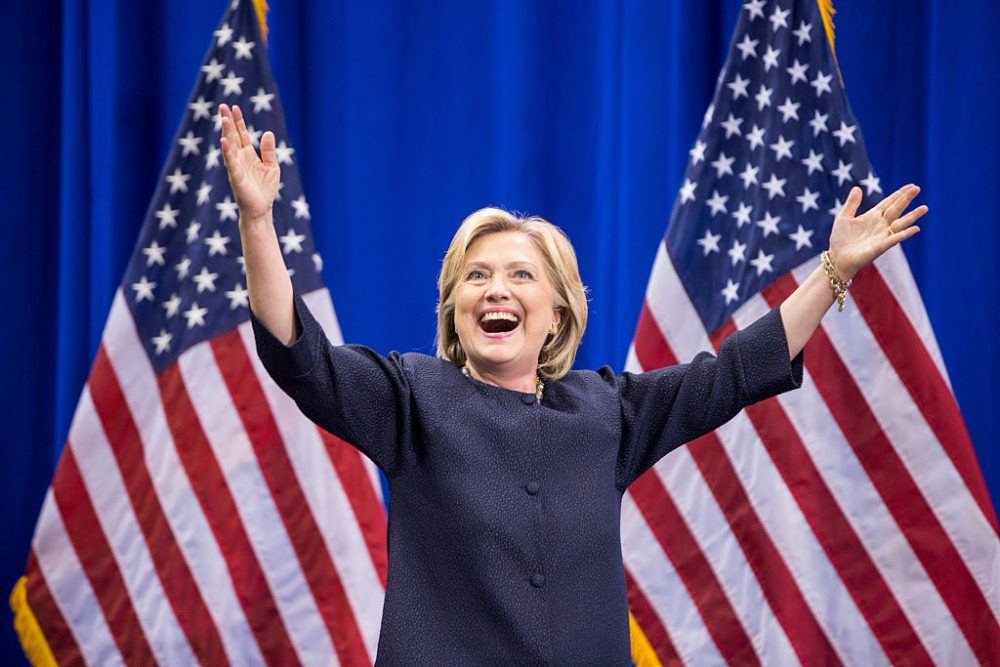 Democratic presidential candidate Hillary Clinton raises her arms stands on stage during the New Hampshire Democratic Party Convention at the Verizon Wireless Center on September 19, 2015 in Manchester, New Hampshire. (Scott Eisen/Getty Images)