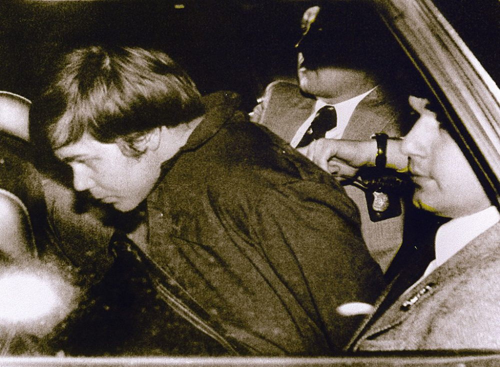 A March 30, 1981 file photo shows John Hinckley Jr. (L) escorted by police in Washington, D.C., following his arrest after shooting and seriously wounding then-President Ronald Reagan. (AFP/AFP/Getty Images)