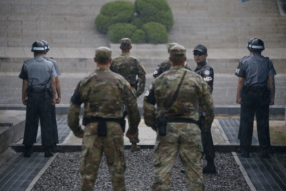 South Korea and U.S. soldiers stand guard during a ceremony marking the 63rd anniversary of the signing of the Korean War ceasefire armistice agreement at the truce village of Panmunjom, along the Demilitarized Zone (DMZ) on July 27, 2016. (Kim Hong-Ji/AFP/Getty Images)