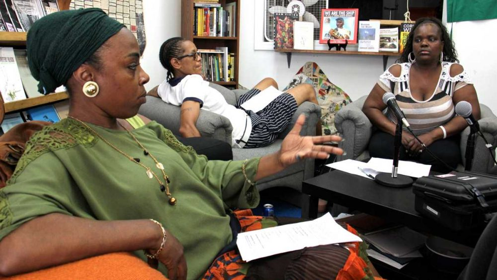 Michelle Scales (left), Faith Bartley (center), and Stephanie Jackson work on a radio program aimed at offering support to former inmates, like them, who face difficulty finding jobs and housing while battling pressures to return to the lifestyles that landed them in prison in the first place. (Emma Lee/WHYY)