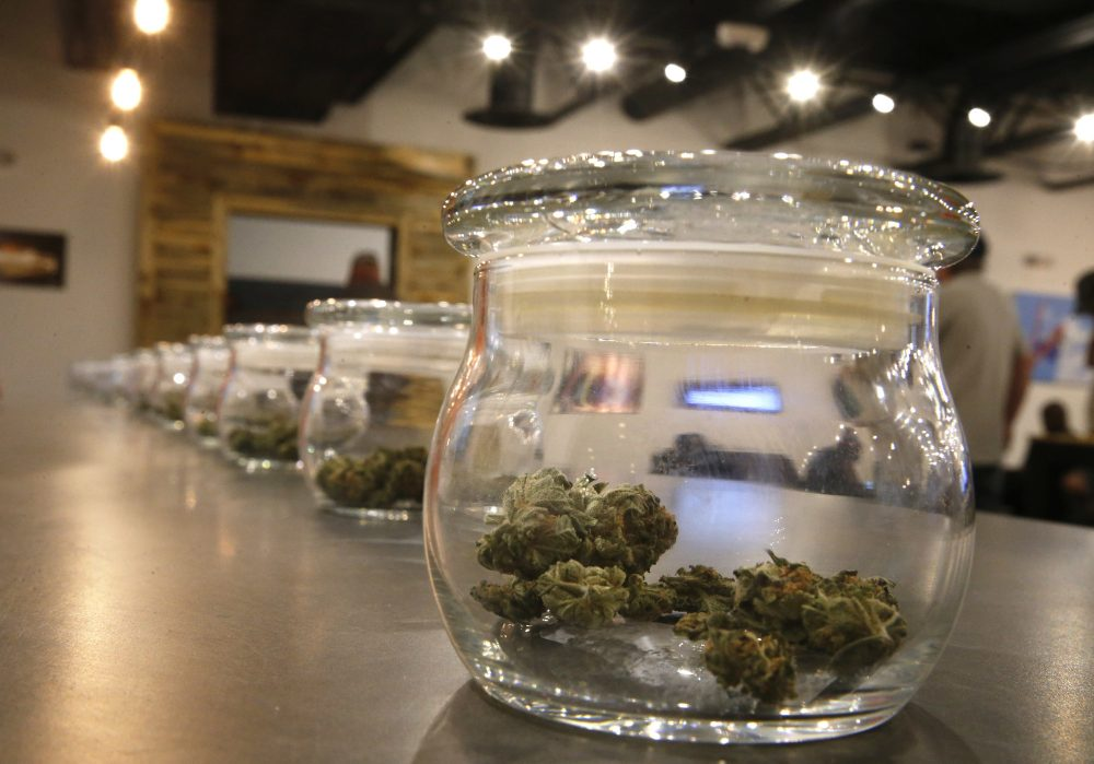 Marijuana for sale kept in jars for customers to sample smells at a recreational marijuana store in Aurora, Colorado. (Brennan Linsley/AP)