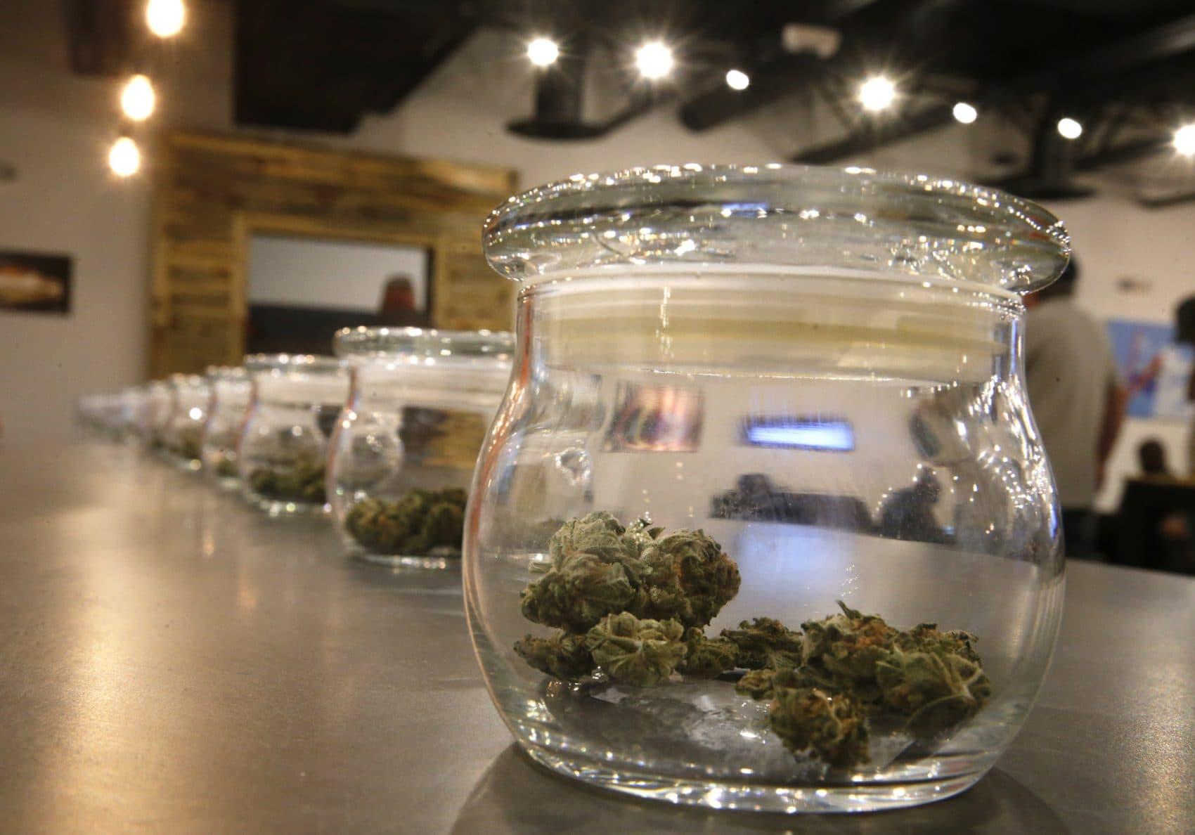 Marijuana for sale kept in jars for customers to sample smells at a recreational marijuana store in Aurora, Colorado. (Brennan Linsley/AP)