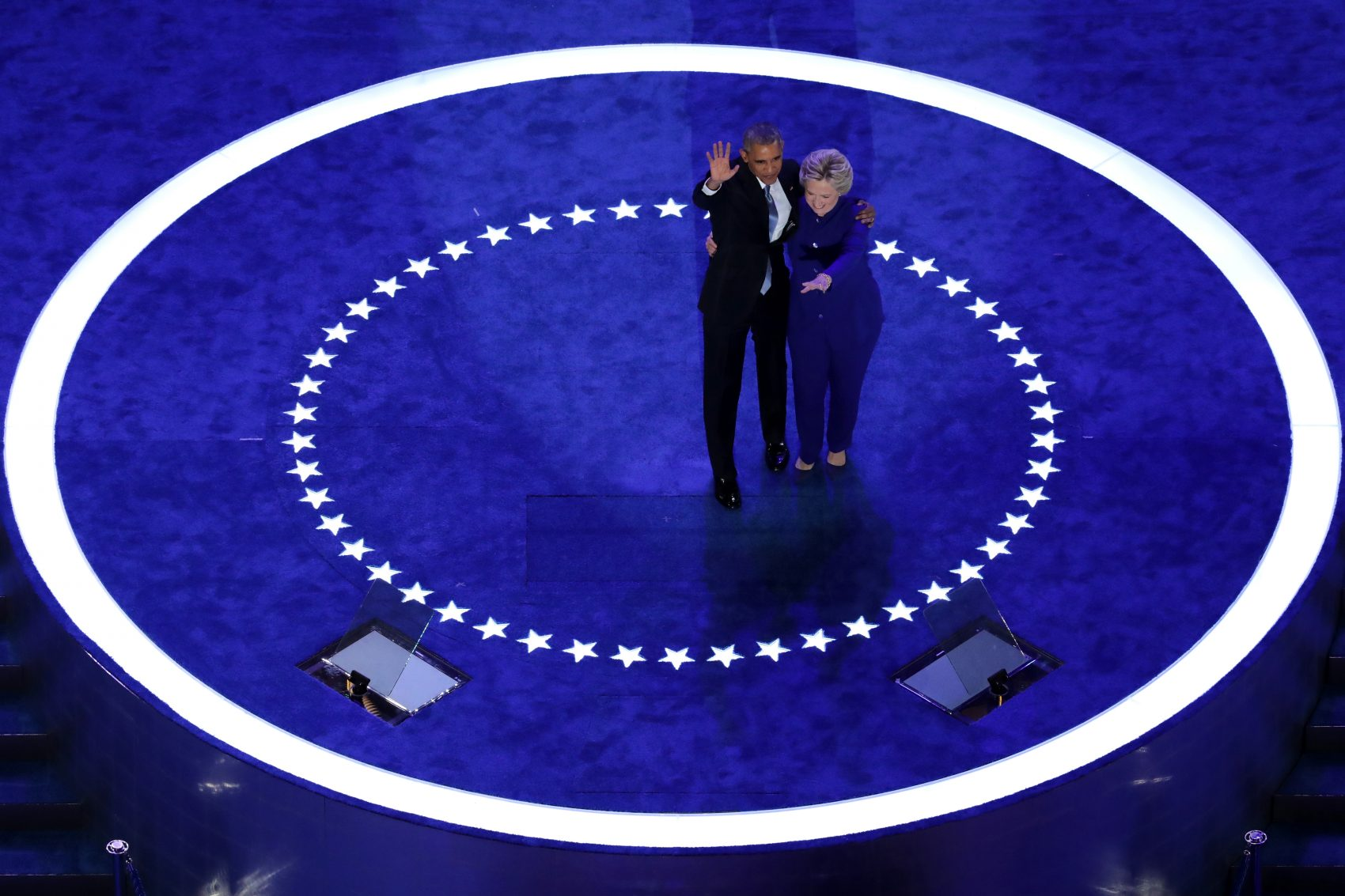 President Barack Obama and Democratic presidential nominee Hillary Clinton wave to the crowd on the third day of the Democratic National Convention at the Wells Fargo Center, July 27, 2016 in Philadelphia. (Chip Somodevilla/Getty Images)