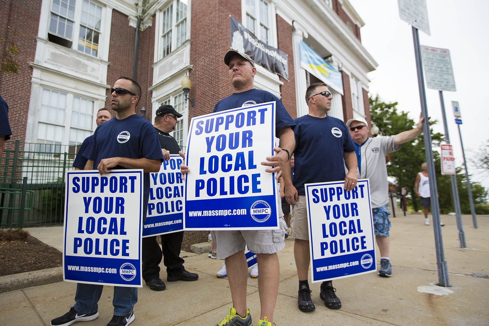 Police officers rally in front of Somerville City Hall. A Black Lives Matter banner has been hanging outside of City Hall for a year, but now police are asking the mayor to take it down. (Jesse Costa/WBUR)