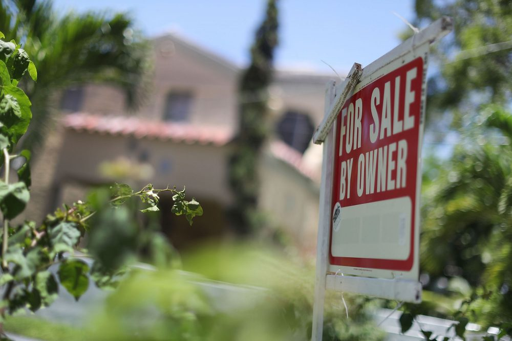 A for sale sign is seen in front of a home on June 22, 2016 in Miami, Florida. (Joe Raedle/Getty Images)