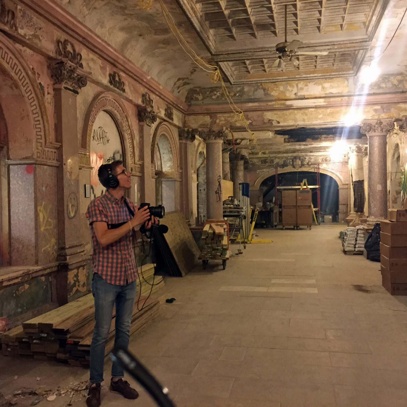 Here & Now producer Dean Russell stands in the first floor of the Divine Lorraine Hotel in North Philadelphia. (Robin Young/Here & Now)