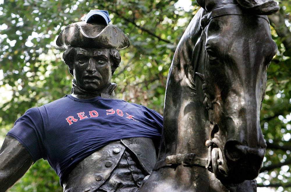 The statue of Paul Revere sported a Red Sox cap and jersey in Boston's North End neighborhood on Sunday, Oct. 17, 2004, when the Boston pro baseball team was down 3-0 against the New York Yankees in the American League Championship Series. (AP Photo/Michael Dwyer)