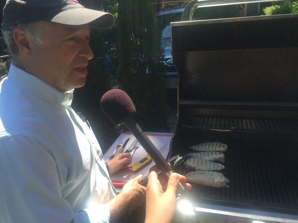 "Greg Blonder, co-author of ""Meathead: The Science of Great Barbecue and Grilling,"" demonstrates four ways to grill a chicken. (Alison Bruzek/WBUR)"