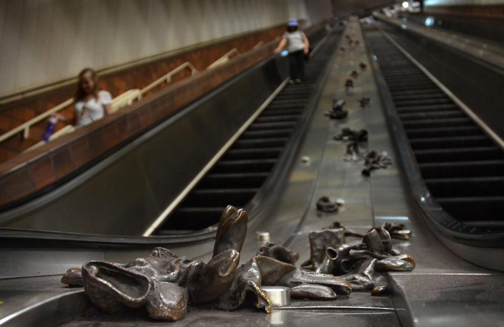 """""""Glove Cycle"""" by Mags Harries, 1984. Inside Porter Square MBTA stop, Cambridge. (Robin Lubbock/WBUR)"""