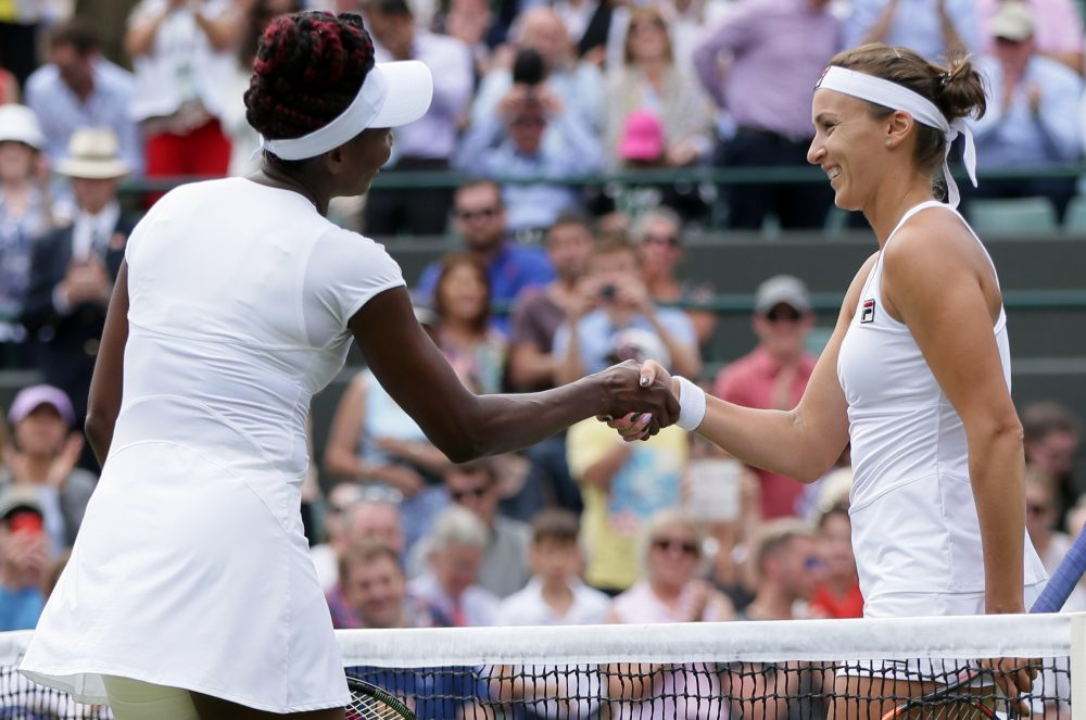 Venus Williams of the U.S, left, shakes hands with Yaroslava Shvedova of Kazahkstan after beating her in their women's singles match on day nine of the Wimbledon Tennis Championships in London, Tuesday, July 5, 2016. (AP Photo/Tim Ireland)