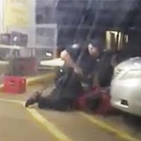 In this Tuesday, July 5, 2016 photo made from video, Alton Sterling is held by two Baton Rouge police officers, with one holding a hand gun, outside a convenience store in Baton Rouge, La. Moments later, one of the officers shot and killed Sterling, a black man who had been selling CDs outside the store, while he was on the ground. (Arthur Reed/AP)