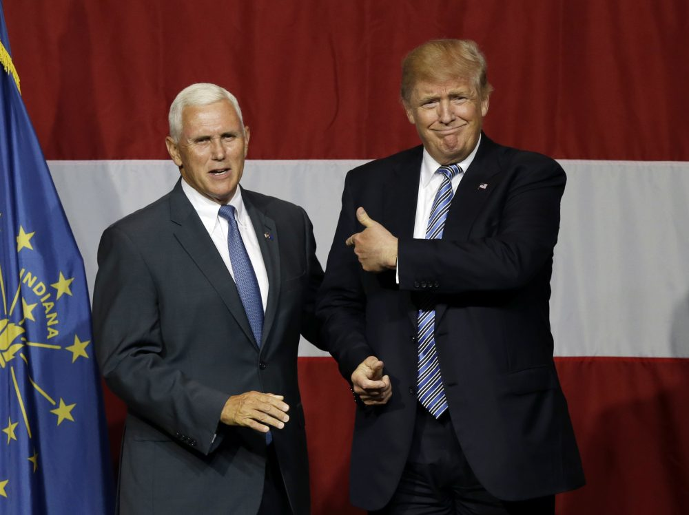 Indiana Gov. Mike Pence with Republican presumptive presidential candidate Donald Trump at a rally in Indiana. (Michael Conroy/AP)
