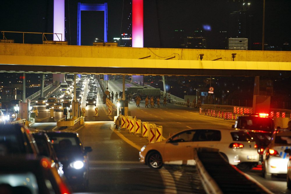 Turkish soldiers block Istanbul's iconic Bosporus Bridge on Friday. The bridge was lit in the colors of the French flag in solidarity with the victims of Thursday's attack in Nice. A group within Turkey's military has engaged in what appeared to be an attempted coup, the prime minister said. (Emrah Gurel/AP)