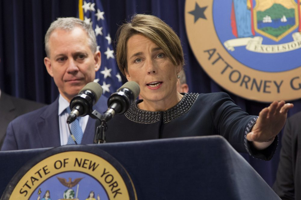 Massachusetts Attorney General Maura Healey, right, joined by New York Attorney General Eric Schneiderman, discusses a lawsuit against Volkswagen on Tuesday in New York. (Mark Lennihan/AP)