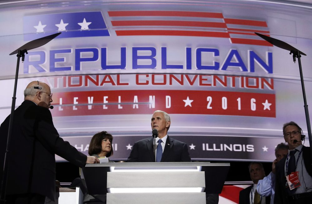 Vice Presidential nominee Gov. Mike Pence and his wife Karen stand on stage before the third day session of the GOP 2016 Convention. (John Locher/AP)