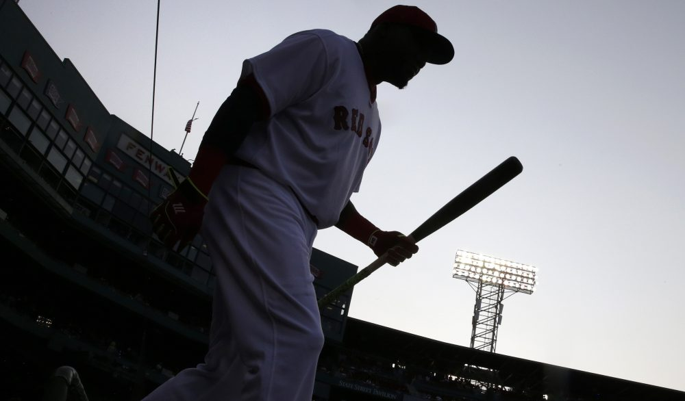 Boston Red Sox designated hitter David Ortiz walks from the dugout to warm up prior to a baseball game against the San Francisco Giants at Fenway Park, Wednesday, July 20, 2016, in Boston. (AP Photo/Charles Krupa)