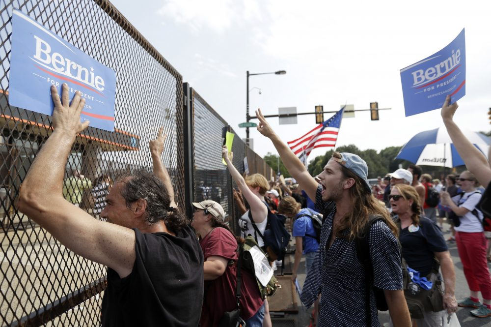 Supporters of Bernie Sanders show signs to Democratic National Convention goers during a protest Monday in Philadelphia. (Matt Slocum/AP)