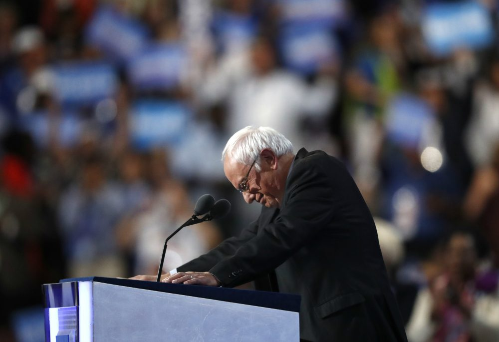 Former Democratic Presidential candidate, Sen. Bernie Sanders, I-Vt., stands at the podium as he is greeted by massive applause during the first day of the Democratic National Convention in Philadelphia , Monday, July 25, 2016. (Paul Sancya/AP)