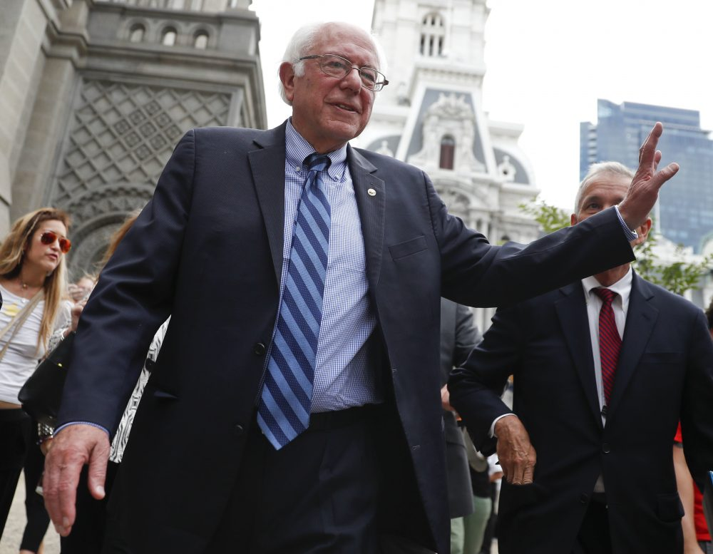 Sen. Bernie Sanders waves to a supporter in downtown Philadelphia on Thursday, during the final day of the Democratic National Convention. (John Minchillo/AP)