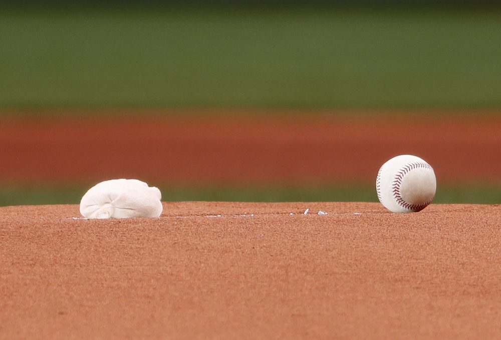 A rosin bag and a baseball on the pitchers mound at Fenway Park (Winslow Townson/AP)