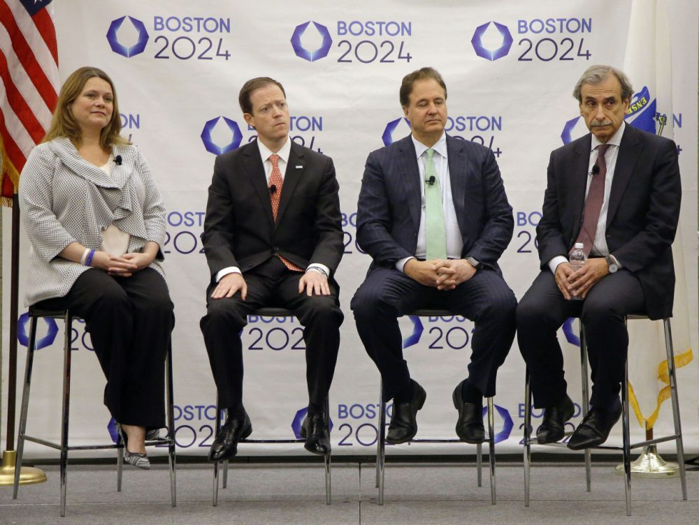 From left to right, Boston 2024 COO Erin Murphy, CEO Rich Davey, Chairman Steve Pagliuca and architect David Manfredi listen to questions during a media availability in 2015 after releasing the group's revised bid for the 2024 Summer Olympics. (Stephan Savoia/AP)