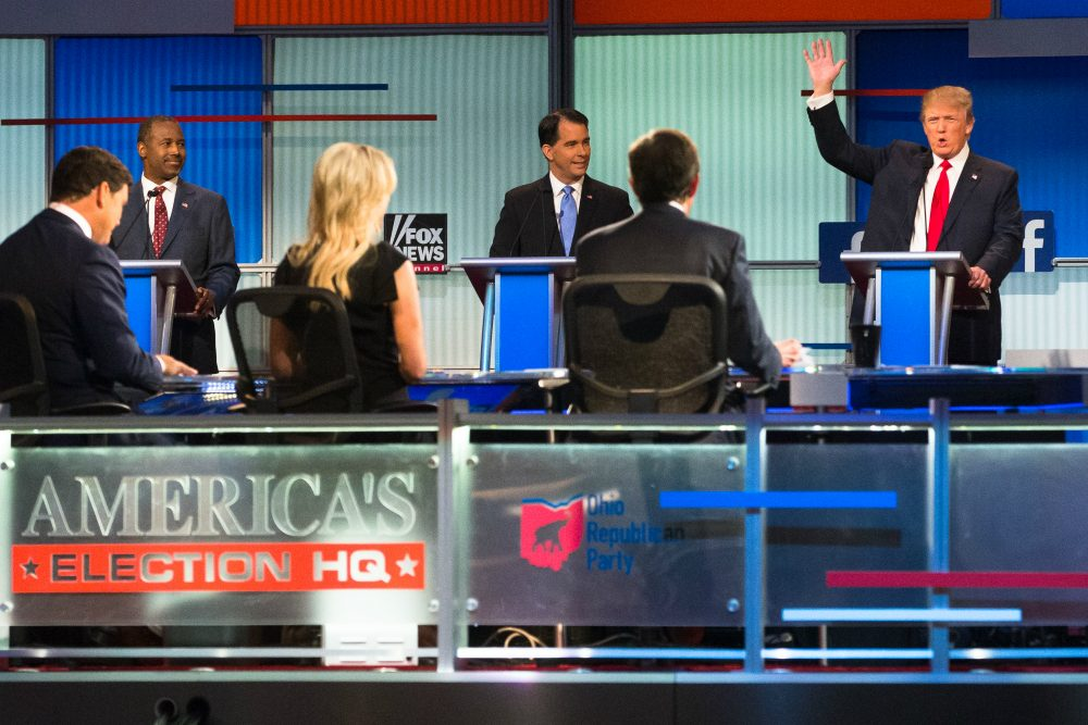 Republican presidential candidate Donald Trump, right, speaks to moderators from left foreground, Bret Baier, Megyn Kelly and Chris Wallace during the first Republican presidential debate at the Quicken Loans Arena Thursday, Aug. 6, 2015, in Cleveland. (John Minchillo/AP)