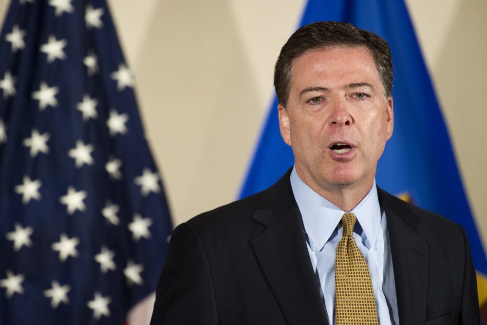 FBI Director James Comey at FBI Headquarters in Washington, Tuesday, said the FBI will not recommend criminal charges in its investigation into Hillary Clinton's use of a private email server while secretary of state. (Cliff Owen/AP)