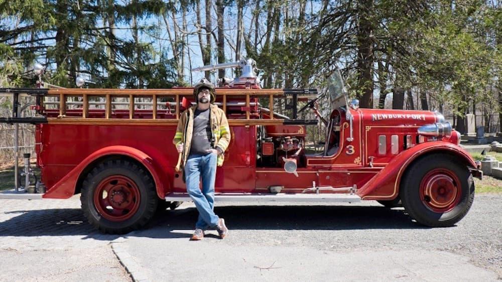 "Joe Hill poses with a firetruck for his latest novel, ""The Fireman"" (Courtesy Jen Salt)"